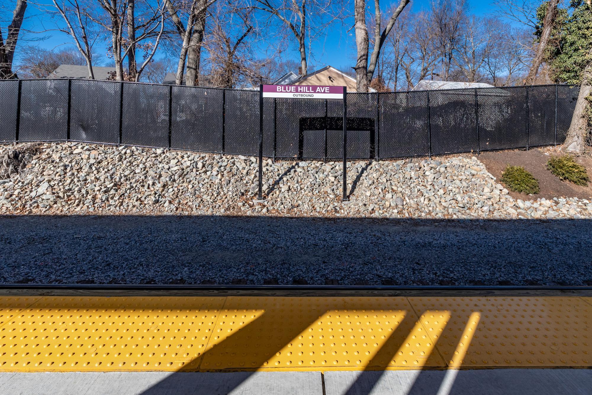 Station sign along the tracks (January 2019)