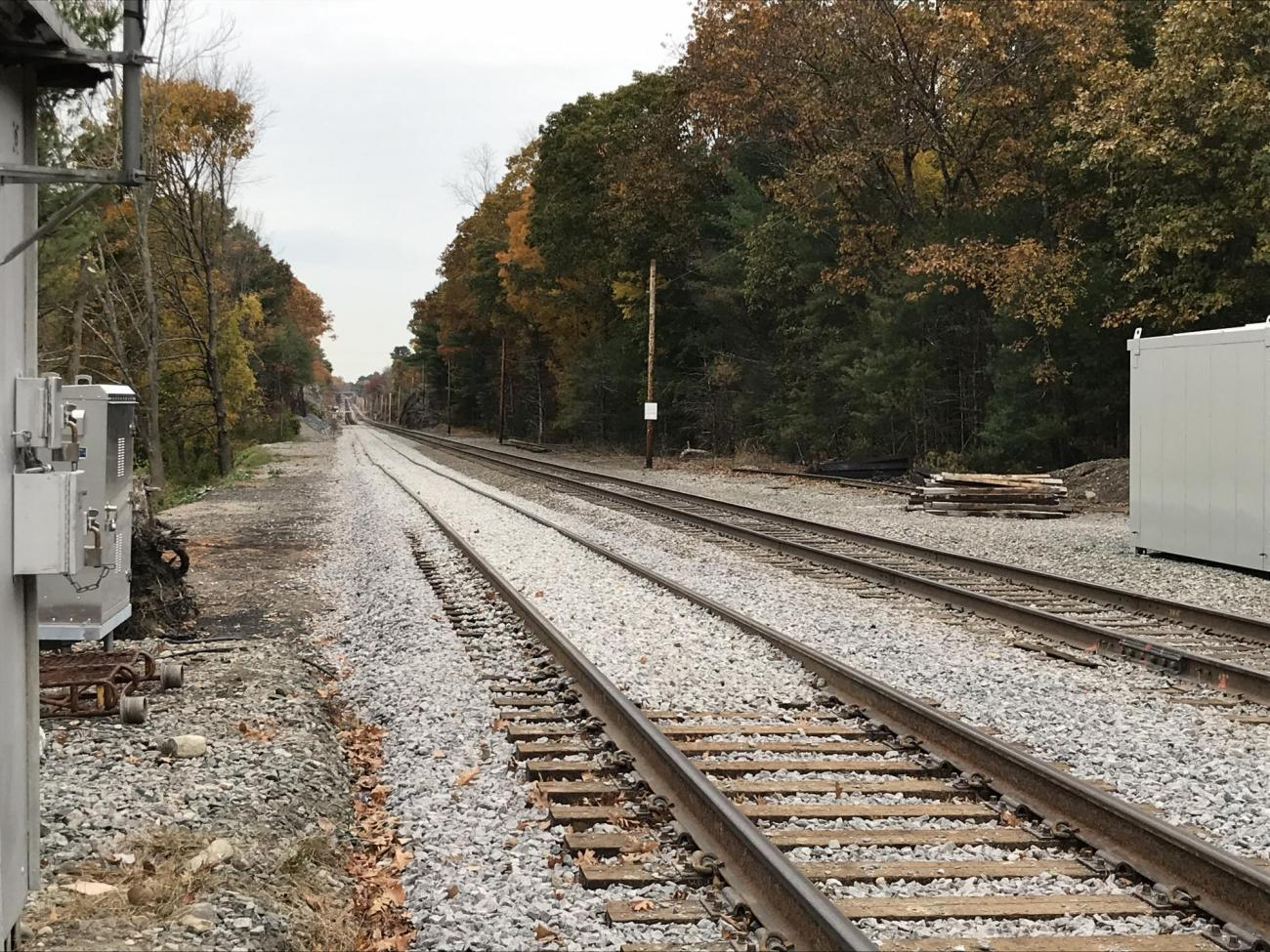 Stone ballast was placed on the tracks before being leveled out by the tamping machine (October 2019)