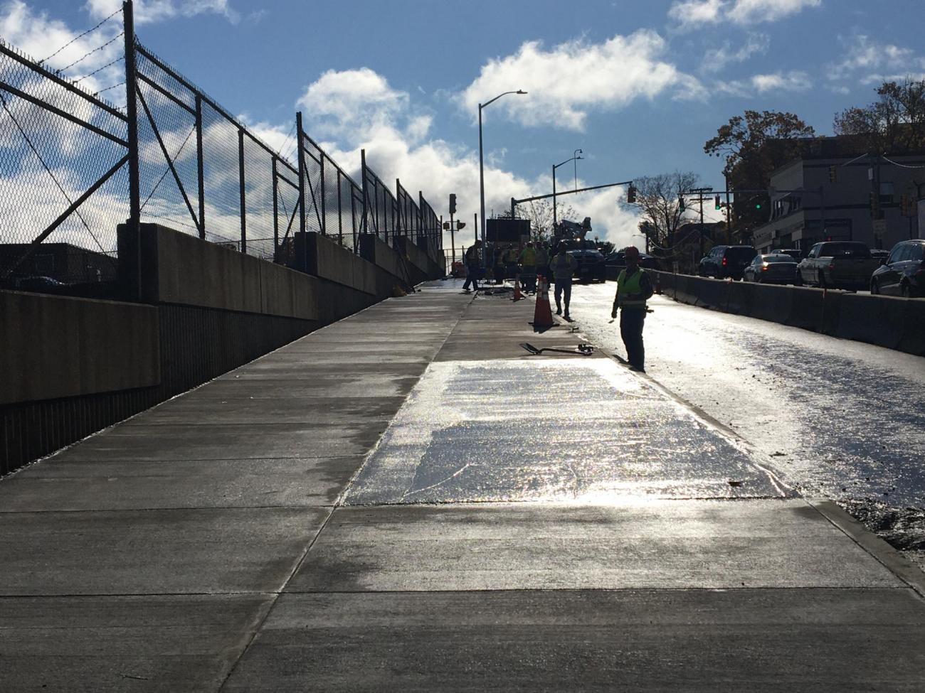 The new sidewalk at Wollaston Station along Newport Ave looking southbound (October 2019)