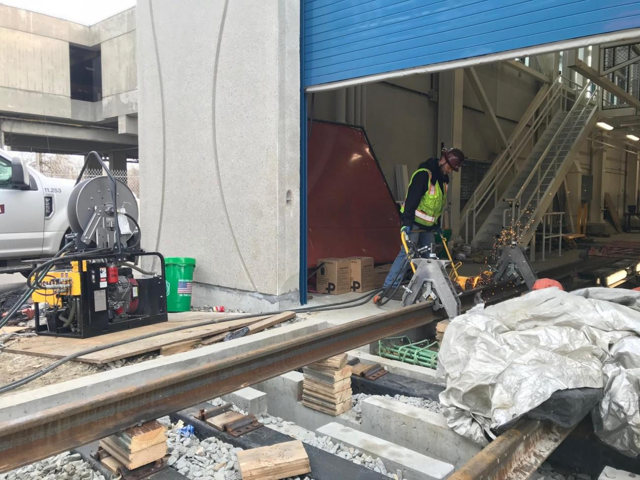 A crew member prepares track for installation at Wellington Yard and Maintenance Facility