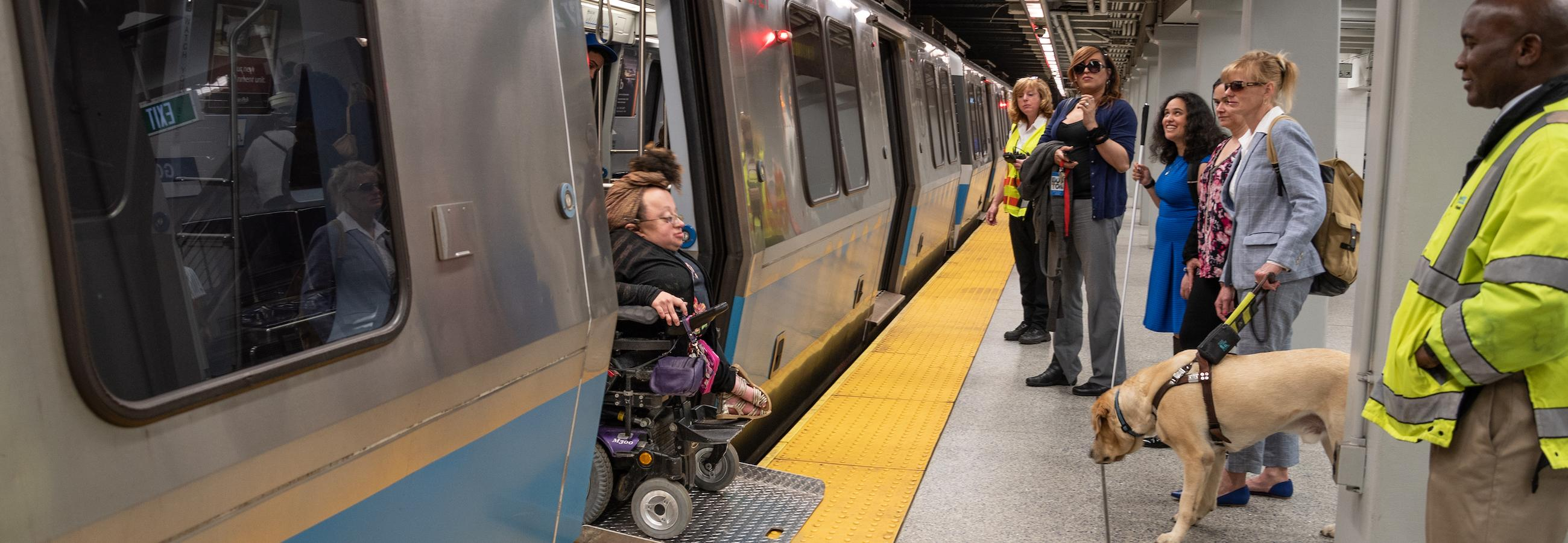 Rider in Wheeled Mobility Device Exiting Blue Line Train with Bridgeplate