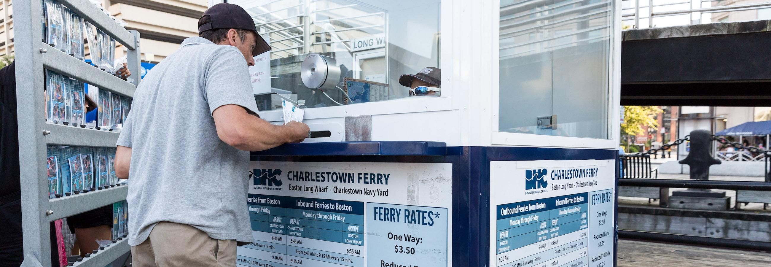 customer buying tickets for charlestown ferry