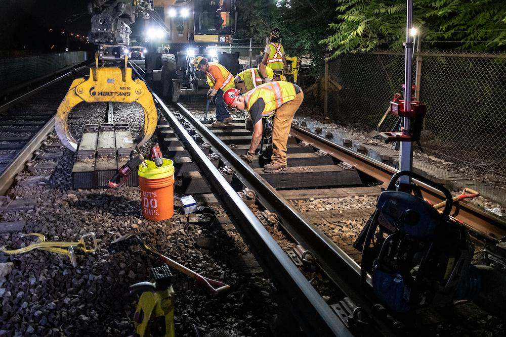 A crew works on the Orange Line in Medford
