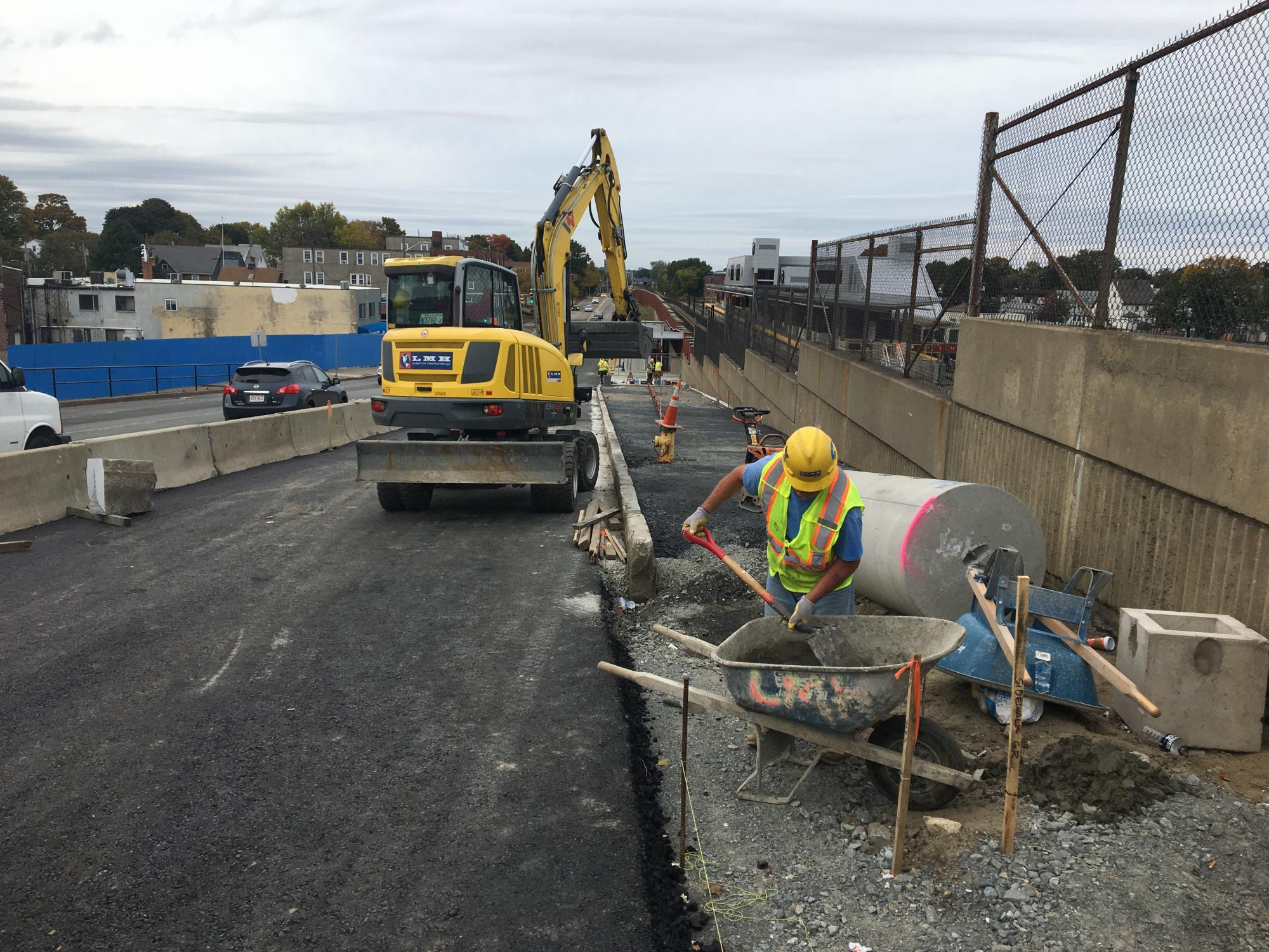 New sidewalk construction at Wollaston Station looking northbound (October 2019)