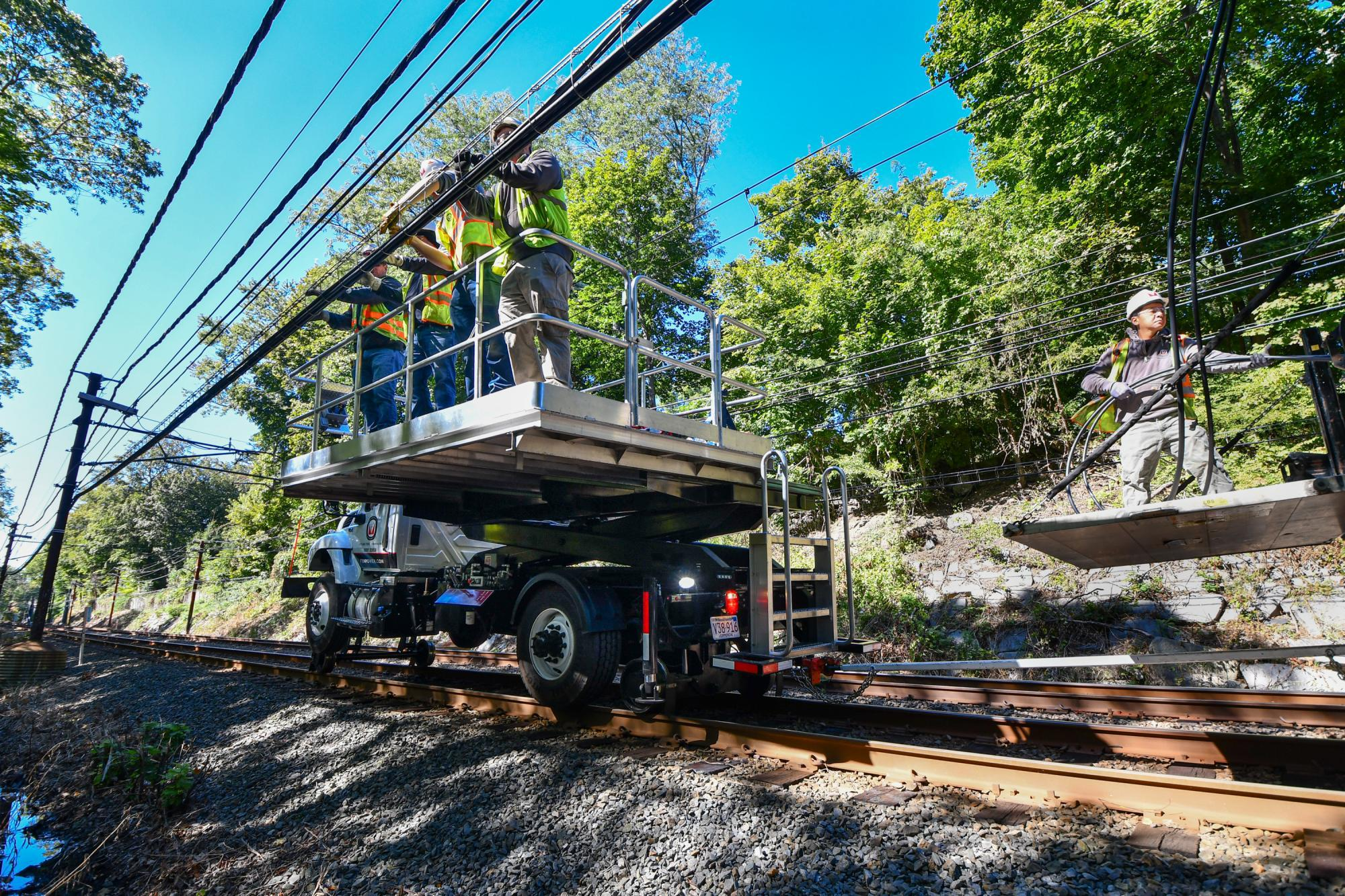 A team of workers install new signal cables near Chestnut Hill on the Green Line D branch.