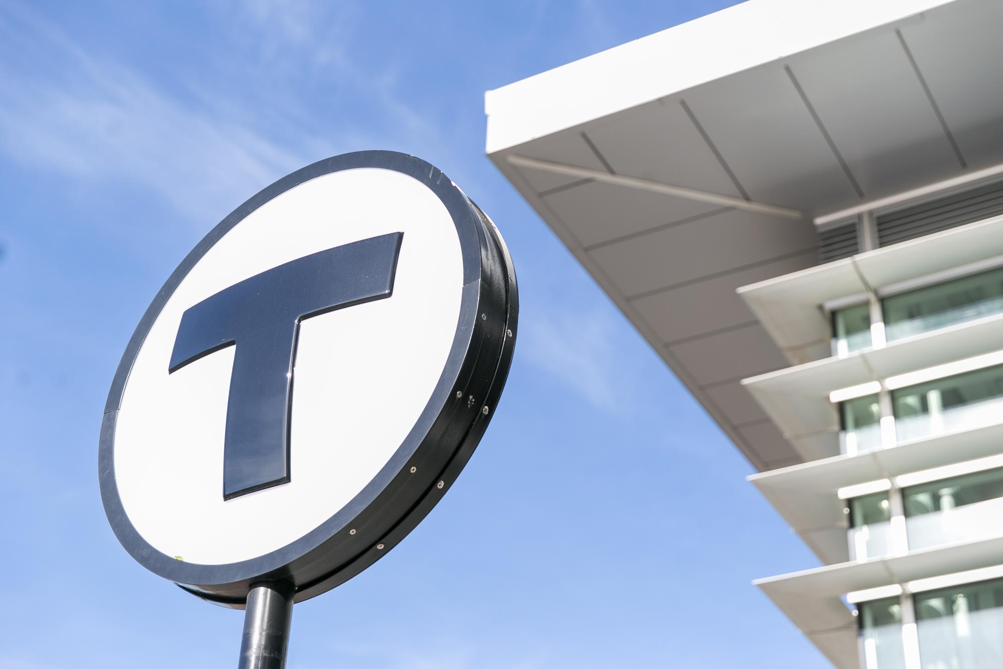 An angled shot of a T logo sign