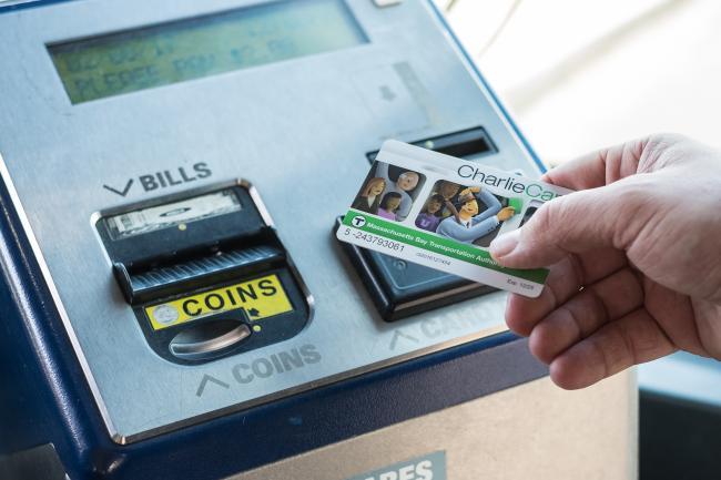 customer tapping charliecard on farebox