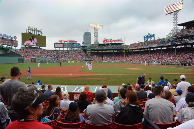 Fenway Park during a baseball game, viewing the playing field from the stands