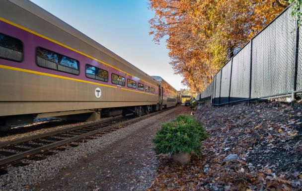 Commuter Rail Train Drives Through Blue Hill Avenue Station in Fall