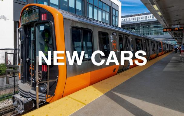 """A new Orange Line train at Assembly Station, with white text overlaid reading """"New Cars"""""""