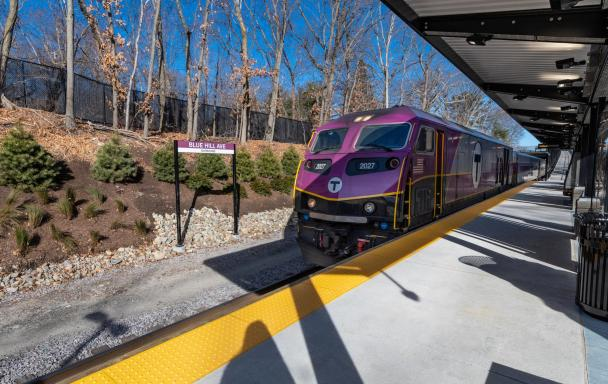 A Commuter Rail train pulls into the outbound platform at Blue Hill Avenue Station.